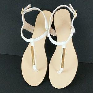 Calvin Klein white and gold T-strap sandals